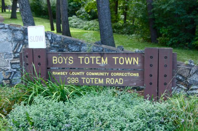 """Could Boys Totem Town be an oddly named park? Based upon the look of the sign, yes, until you notice the small print saying """"Ramsey County Community Corrections."""""""