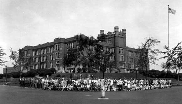 Students pose outside Central about 1928. The castle-like structure above the main entrance was the defining feature of the 1912 Central building.