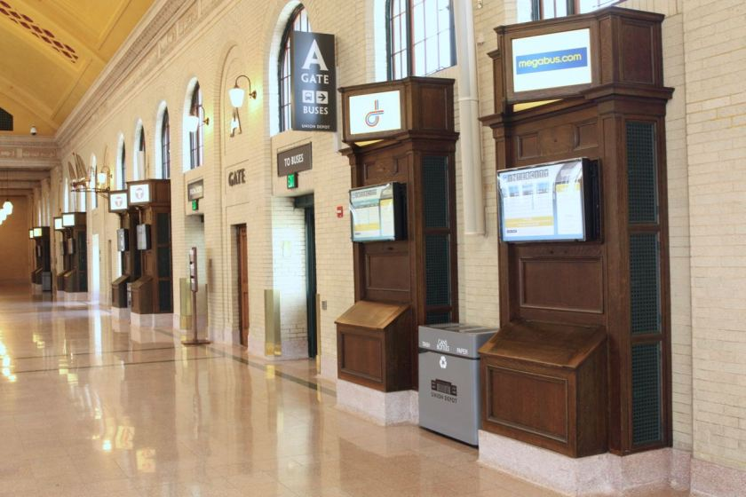 In earlier days, the wood cases on the right were used to display the train schedules for the 21 passenger tracks that served Union Depot. Today, digital screens provide schedules for the bus lines service the Depot.