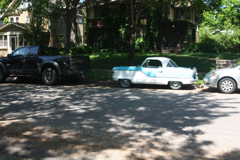 Over in Macalester-Groveland, this Nash Metropolitan hardtop model from between 1955 and 1958, sat near the corner of Saratoga and Portland. The reason it looks tiny is that it is. At 149.5 inches long, it is shorter than an original VW bug.