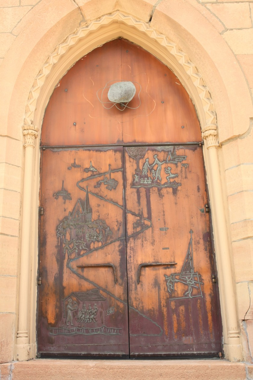 Copper doors, etched with scenes from First Baptist's history, were added in 1971.