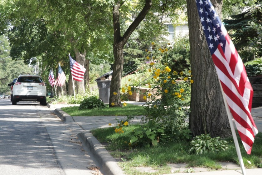 American flags line the boulevard on Burns Avenue.