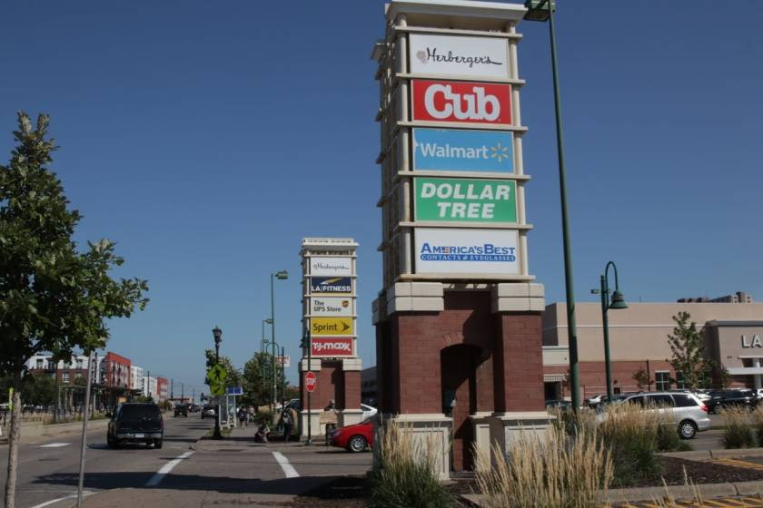 The signs along University Avenue for the suburban-style Midway Marketplace, built in 1994. Two of the main stores had been shuttered – Herberger's in 2018 and Walmart in 2019, though their names remained on the signs.