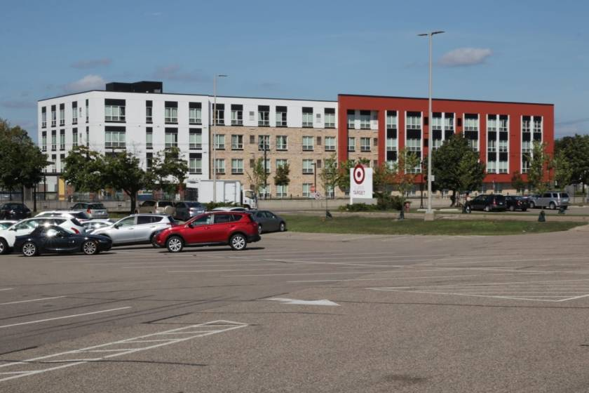 Part of Target's north parking lot. The 108 unit Hamline Station Apartments, owned by the nonprofit Project for Pride In Living, (PPL) is in the four story building.