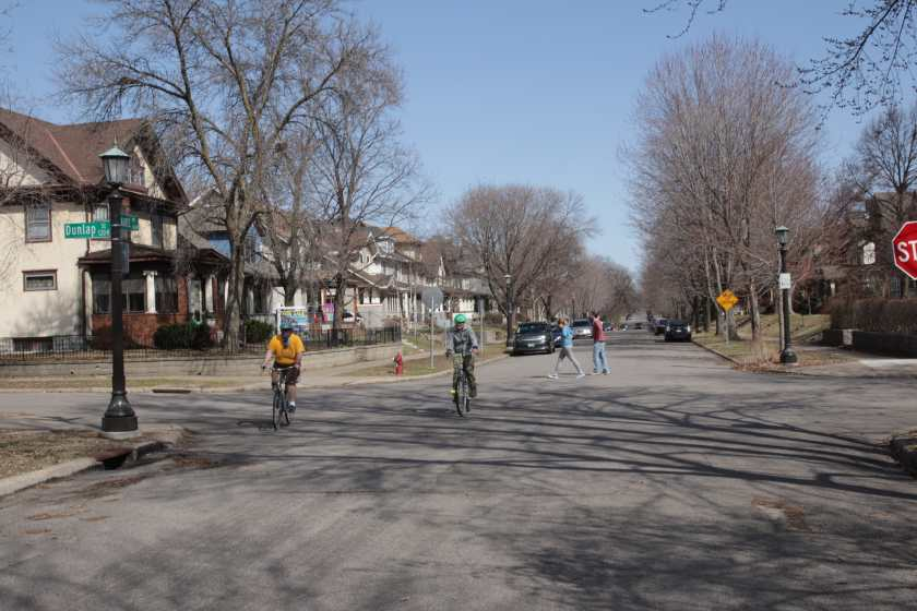 Bikers and walkers kept their distance at Laurel and Dunlap in the Summit-University neighborhood.