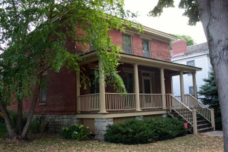 The Simpson-Wood House dates to about 1853. Constructed on Sherman Street, it was moved to 32 Irvine Park in 1978 according to the AIA Guide to the Twin Cities by Larry Millett.