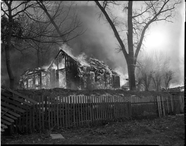 After all the residents of Swede Hollow were gone, the City of Saint Paul burned down the remaining structures. December 1956. Courtesy of the Minnesota Historical Society.