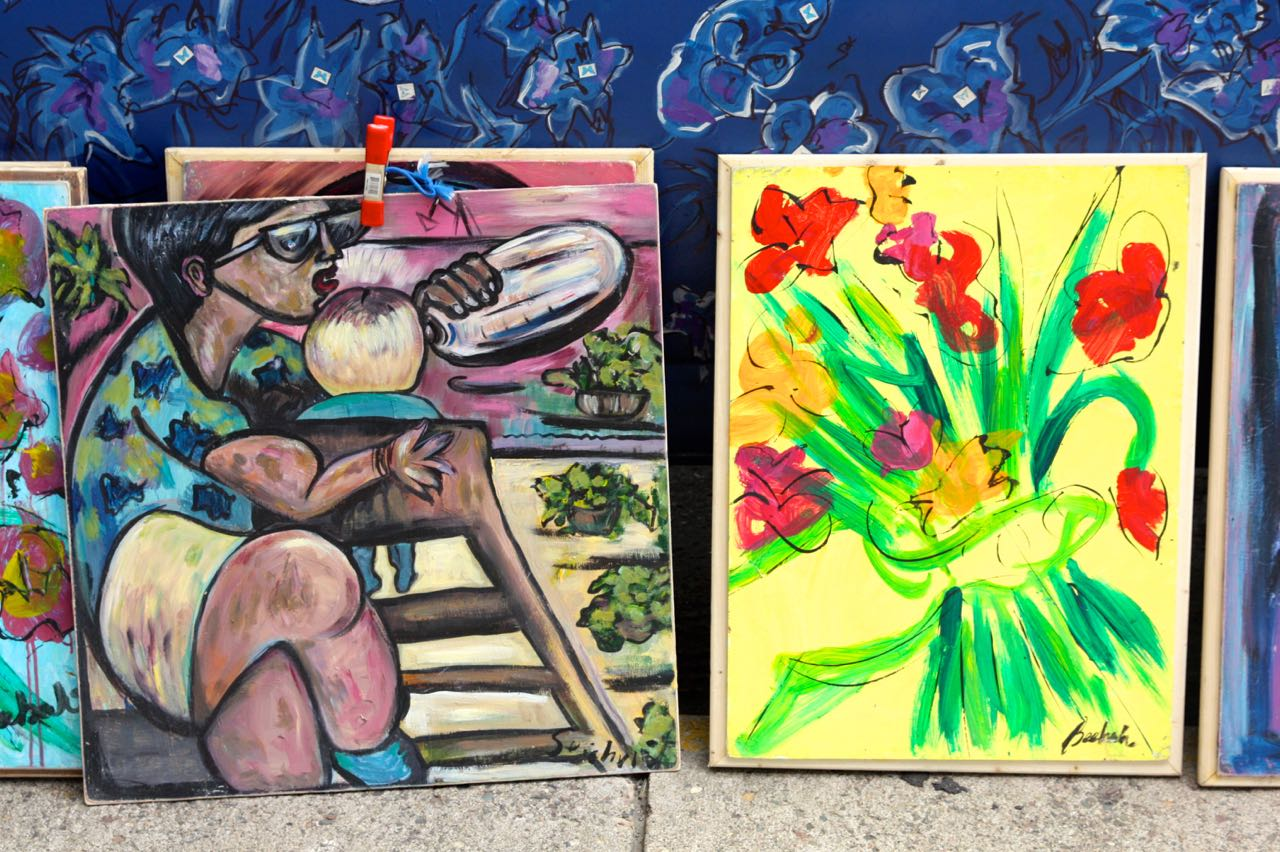 A couple of the dozens of original acrylic paintings for sale at mobile art gallery.
