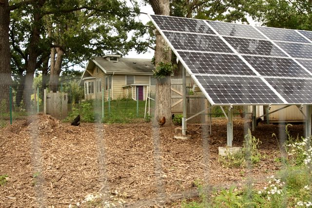 A large solar array acts like a privacy fence for 561 Burlington.