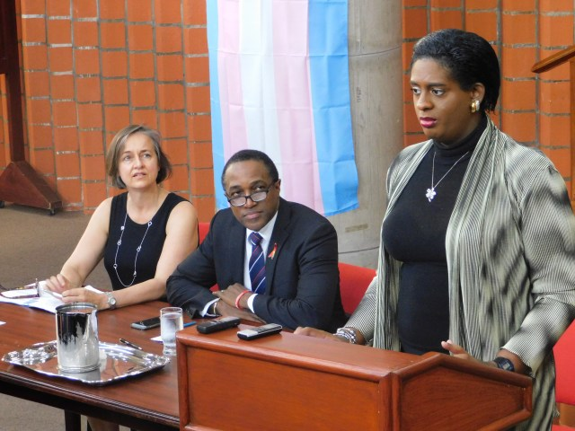 Yvonne Chisholm, pro bono counsel, and Maurice Tomlinson, Legal Network senior policy analyst, listen as petitioner Alexa Hoffman speaks at the press conference, June 6, 2018 (Photo courtesy of the Canadian HIV/AIDS Legal Network)