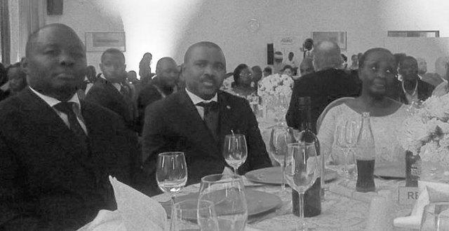 Specioza Kazibwe (right), former Ugandan vice president, and right-to-health activist Kikonyogo Kivumbi (left) at a dinner honoring people promoting improved access to health care for Ugandans. (Photo courtesy of Uhspa Uganda)