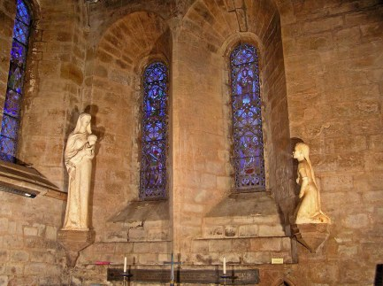 Altar in Chapel of St. Bega's Priory. Statue of Bega praying on the right