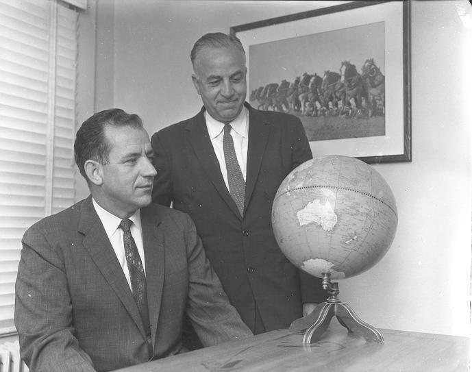 Charles Neff (left) surveying the globe