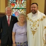 Eugene & Frances Chmiel pictured with Father Roman