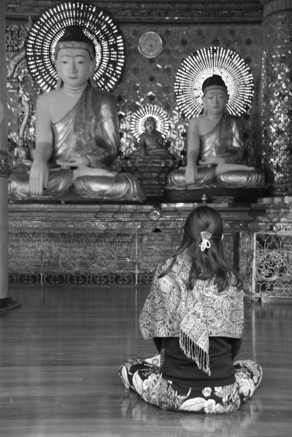 A woman praying at the Shwedagon Pagoda in Yangon