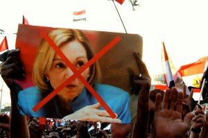 "Opposition protesters in Tahrir Square on July 28, 2013 hold up a picture of then-current US Ambassador to Egpt, Anne Patterson. Anti-Americanism was high in Egypt this summer, particularly after Ambassador Patterson remarked that she was ""deeply skeptical"" that the planned June 30th protests would be fruitful. (SARAH RASHID)"