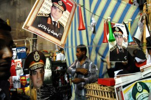 A vendor sells pictures of Minister of Defense Gen. Abdel Fattah al-Sisi in Tahrir Square on July 26, 2013. (SARAH RASHID)