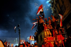 Supporters of the military-backed coup that removed Egypt's first democratically elected president Mohammad Morsi celebrate in Tahrir Square on July 26, 2013. (SARAH RASHID)