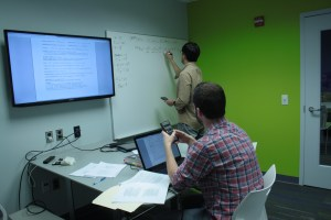 SAIS DC students John Langdon and John Seo use a study room in the learning commons to work on a problem set. (Nimshal Jaiswal)