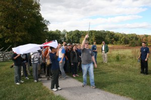 "SAIS second-year Strategic Studies students and Quartermasters of the Gettysburg Campaign Fall Staff Ride, Nate Rozelle and Mike Youn, lead the march and Confederate advance better known as ""Pickett's Charge"". (Jameel Khan)"