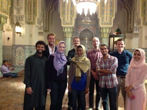 Zeeshan Vazeer, Bo Friddell, Kate Maxwell, Umit Baris Urhan, Michelle Thompson, Selim Koru, Shafi Rehman, Dylan Arnould and Nameerah Hameed stand inside the Islamic Center mosque. (Zeeshan Vazeer)