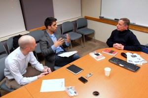 Gutman talks with the Observer editorial staff, Jameel Khan and Selim Koru. (SARAH RASHID)