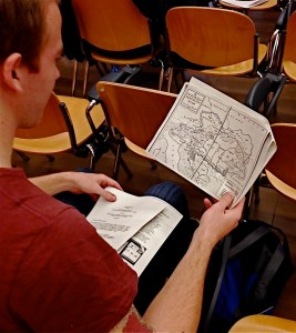 A SAIS Bologna student inspects handouts in preparation for a Core Class. (Rachel Finan)