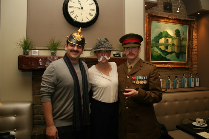 Three of the best-dressed presenters: Idon Natanzon as General Erich Ludendorff, Anne Gillman as Prime Minister David Lloyd George, and Nate Rozelle as Field Marshal Douglas Haig (all MA 14).