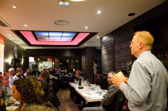 "Retired British General Sir Paul Newton and retired U.S. General Mark Hertling debate the merits of ""amalgamating"" U.S. troops under British command over dinner in Reims.  (Photo: Benji Preminger)"