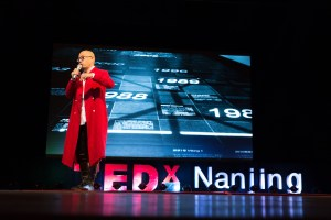 Graphic artist Zhao Qing presents at TedxNanjing on Oct. 19. The annual TEDxNanjing conference showcased the growing presence of independent artists, designers, scientists, entrepreneurs and non-profit organizers in Nanjing.(Photo by Xiang Chengyu)