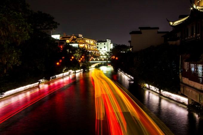 Tour boats glide through the rivers near Fu Zi Miao.