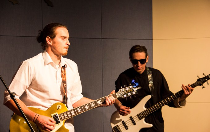 Band members Bret Hine and Chace Flanders jam on stage.