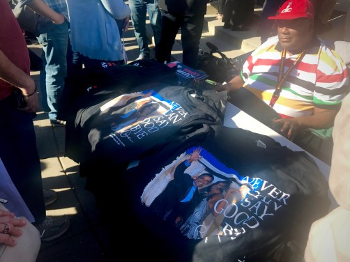 A man sells t-shirts displaying various causes including the Women's March, the Black Lives Matter movement, climate change awareness, and memories of the Obama presidency. (Photo Courtesy: Fatima Nanavati)