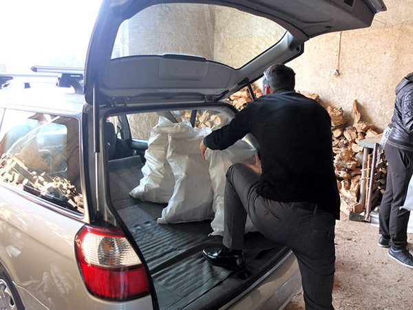 Firewood packed in car for distribution