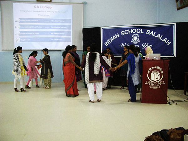 Teachers participate in a role-playing activity