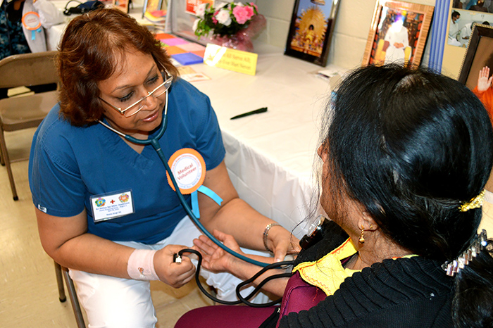 Patient's blood pressure being checked