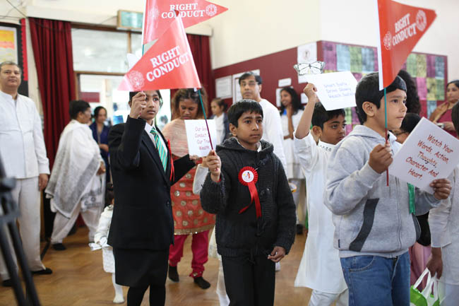 Children displaying flags of Human Values