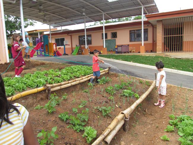 Costa Rica - Children watering the garden