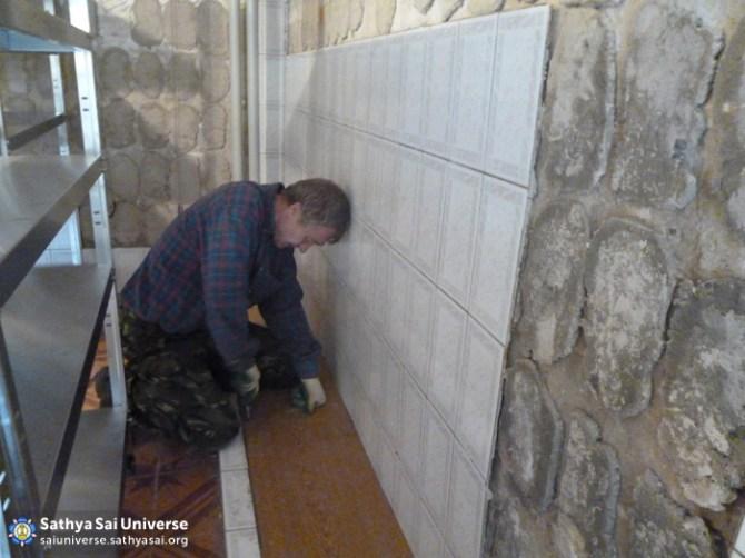 Installing tile at children's shelter