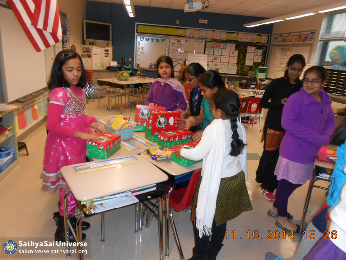 Children preparing gifts for distribution
