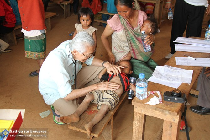 Dr. from Singapore examining a child