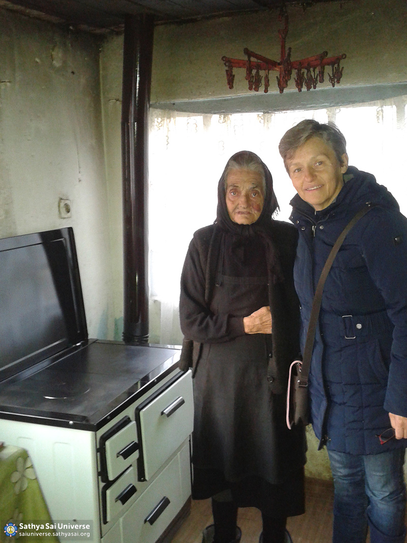 Croatia - An old countrywoman and her new hot furnace