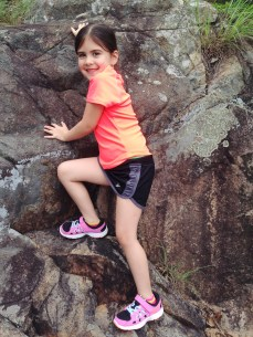 Rock climbing in a tennis skirt takes skill.