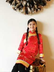 Ada in a traditional CNY dress