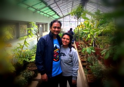 Cute couple in the greenhouse.