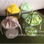 おもちゃ収納に最適な透明巾着、黄色と緑で。/サイト引っ越し構想。