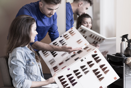 Beauty woman and hairdresser choosing color to dyeing hair