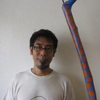 石垣島のカフェ&カレー「トラベラーズカフェ朔」の店長写真
