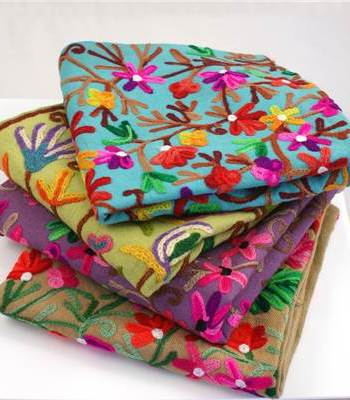 Part crewel cushion covers