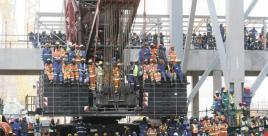 Medupi workers sitting on a crane during President Jacob Zuma's initiating of the Hydrostatic Boiler Pressure Test at Medupi Power Station, Lephalale. Picture: Leon Nicholas